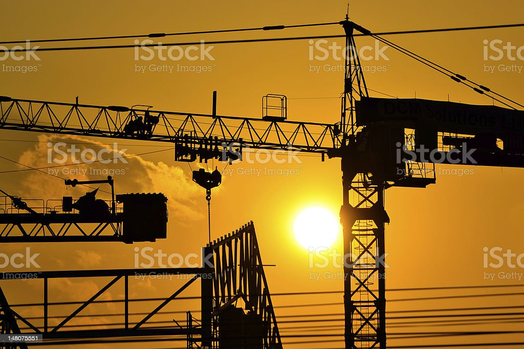 silhouette crane building on sunset time royalty-free stock photo