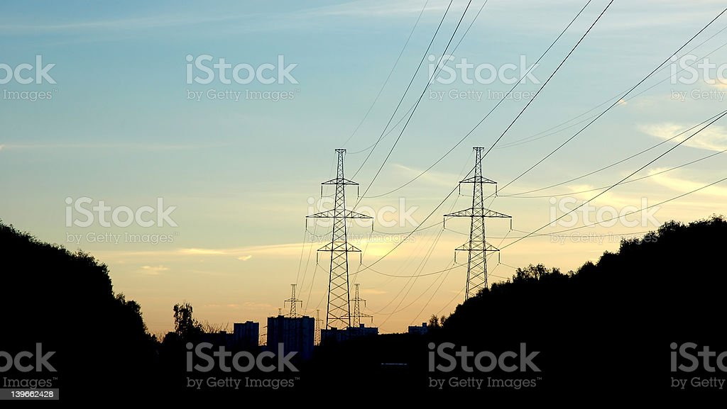 silhouette electrical tower stock photo