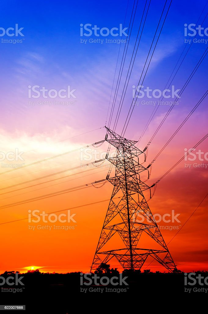Silhouette electricity pylons stock photo
