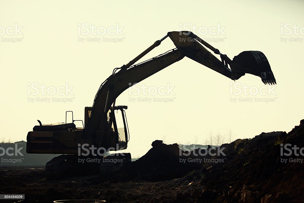 silhouette excavator stock photo