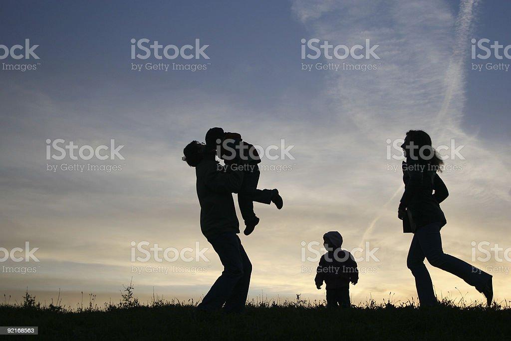 silhouette family of four royalty-free stock photo