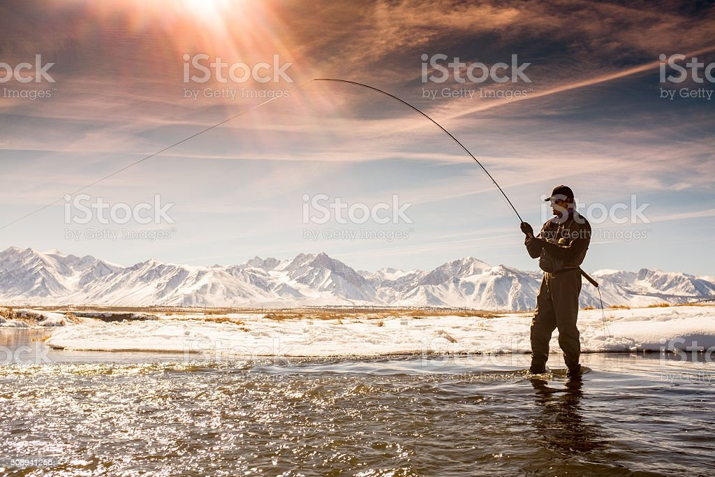 Silhouette Fisherman On The Owens River in Winter stock photo