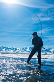 Silhouette Fisherman On The Owens River in Winter