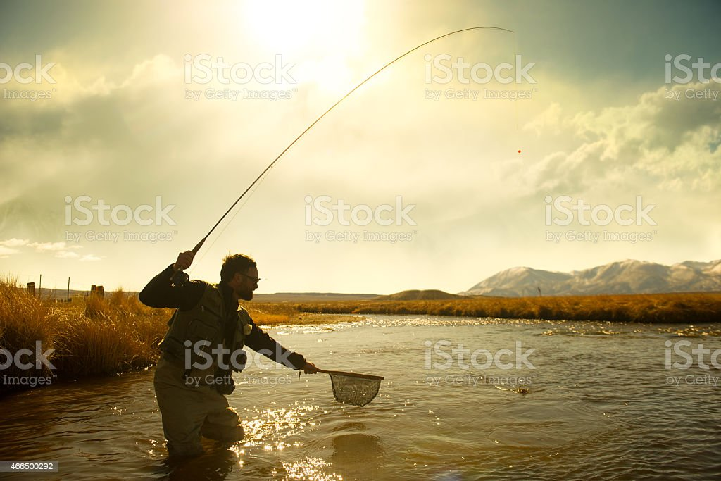 Silhouette Fisherman stock photo