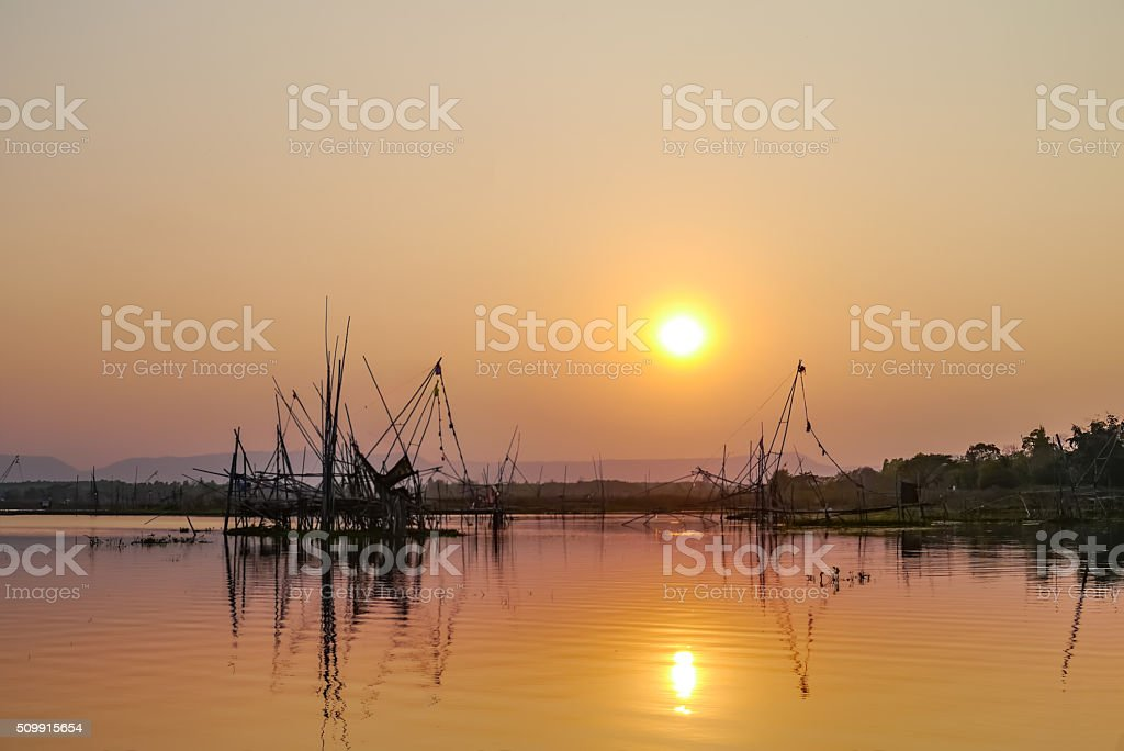 Silhouette fisherman. stock photo