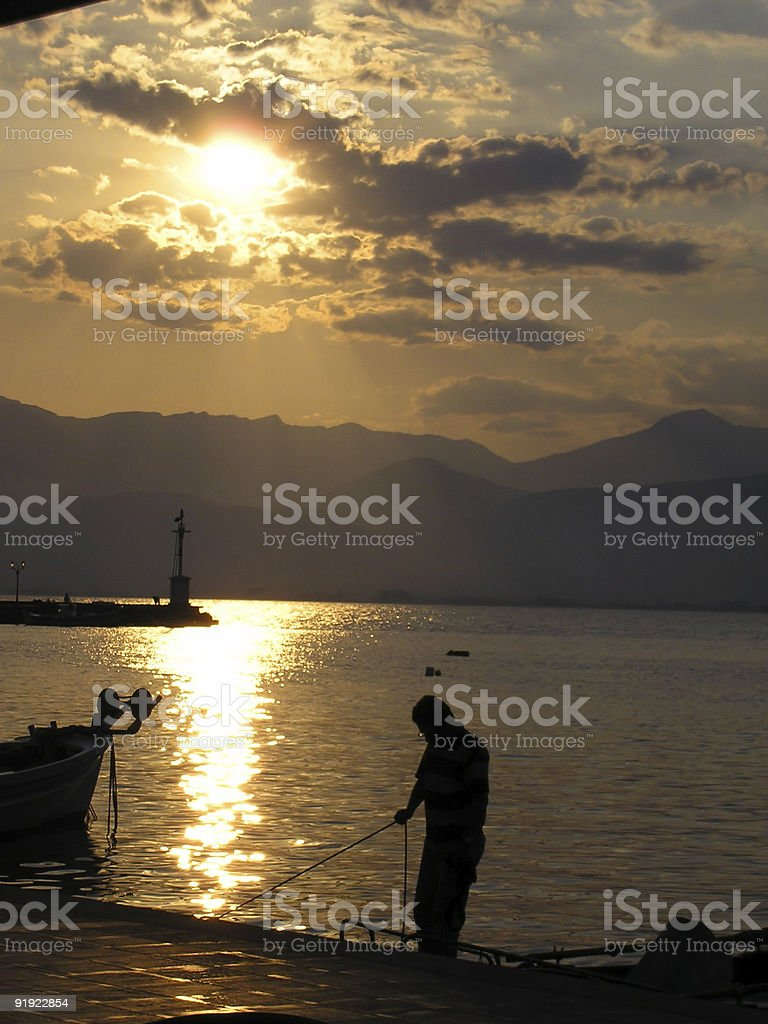 silhouette - fisherman with his boat stock photo