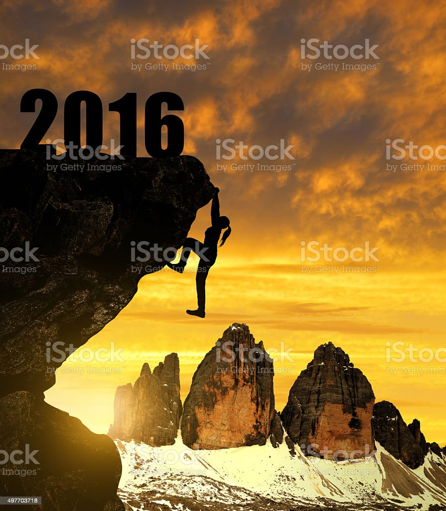 Silhouette girl climbs into the New Year 2016 stock photo