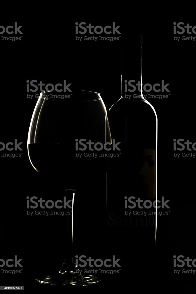 Silhouette Glass with bottle of red wine in backlight stock photo
