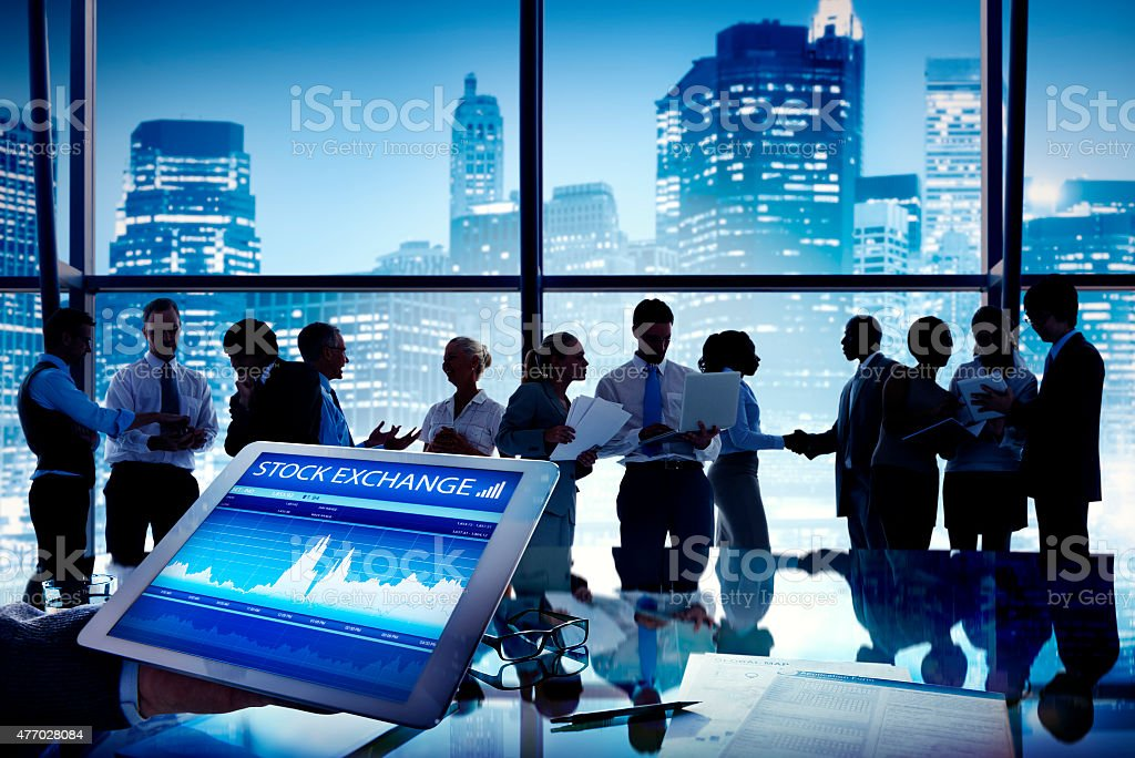 Silhouette Group of Business People Discussion Stock Exchange stock photo