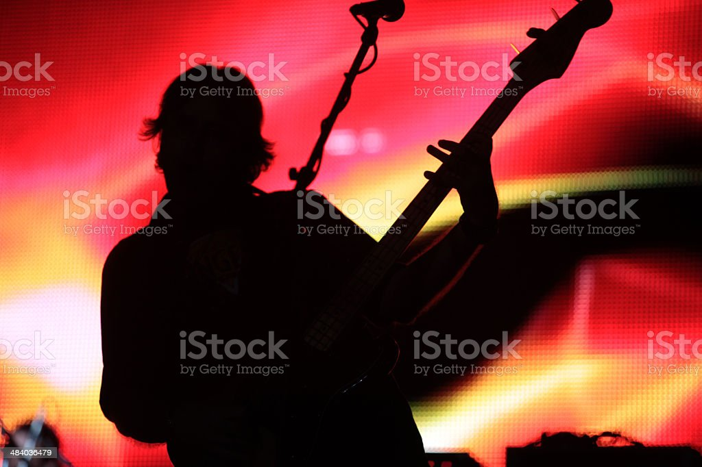 Silhouette Guitar Player with colorful backgrounds stock photo