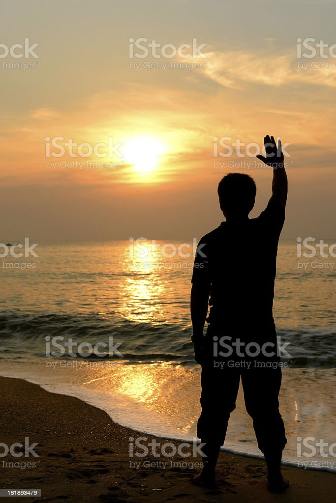 Silhouette happy man at the beach royalty-free stock photo