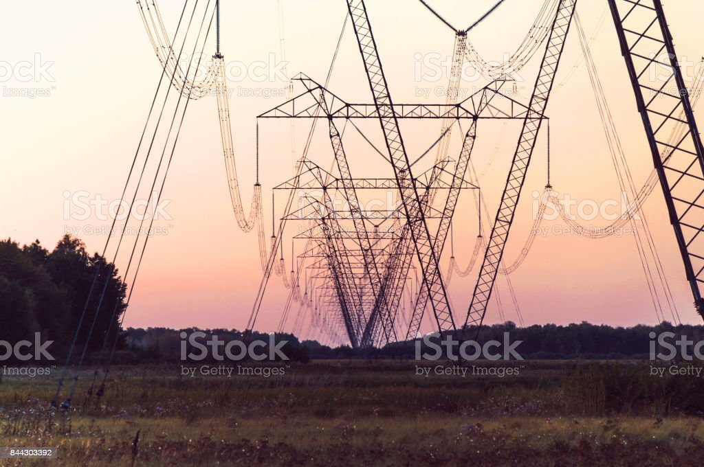 Silhouette High voltage electric tower on sunset time stock photo