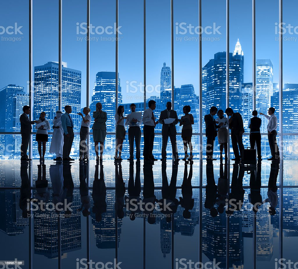 Silhouette image of business people in New york city office royalty-free stock photo