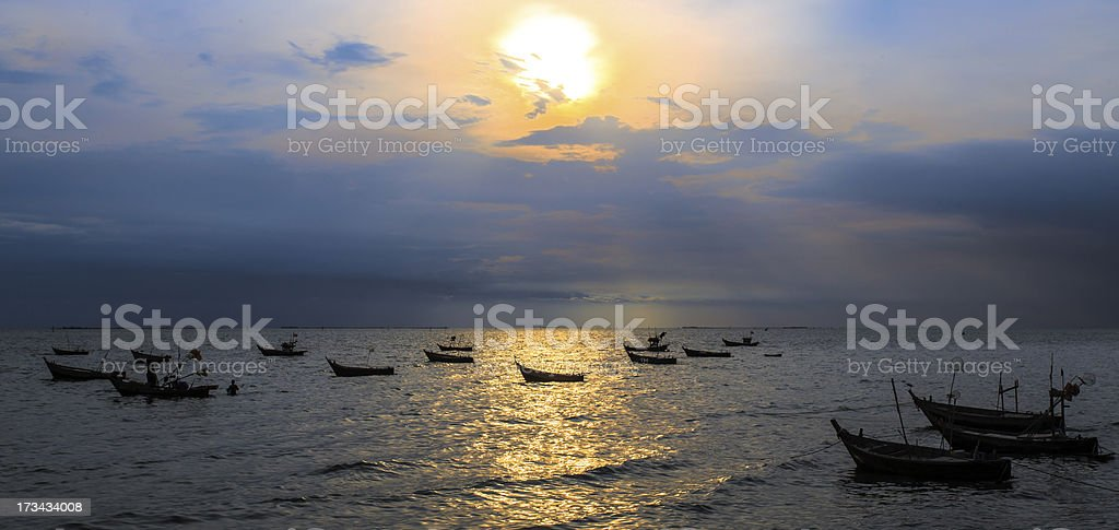 silhouette  image of  fishing boat at beautiful sunset royalty-free stock photo