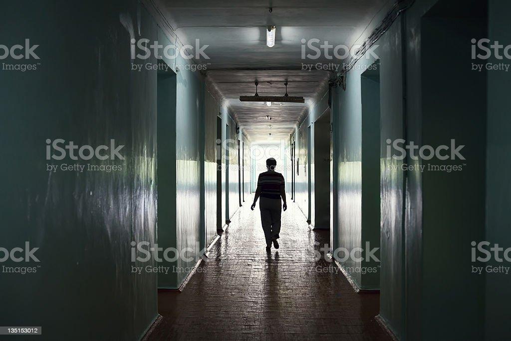 silhouette in a corridor stock photo