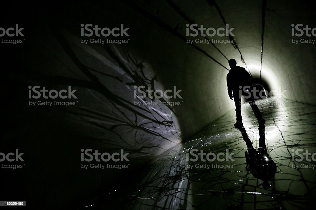 Silhouette in a underground bunker stock photo