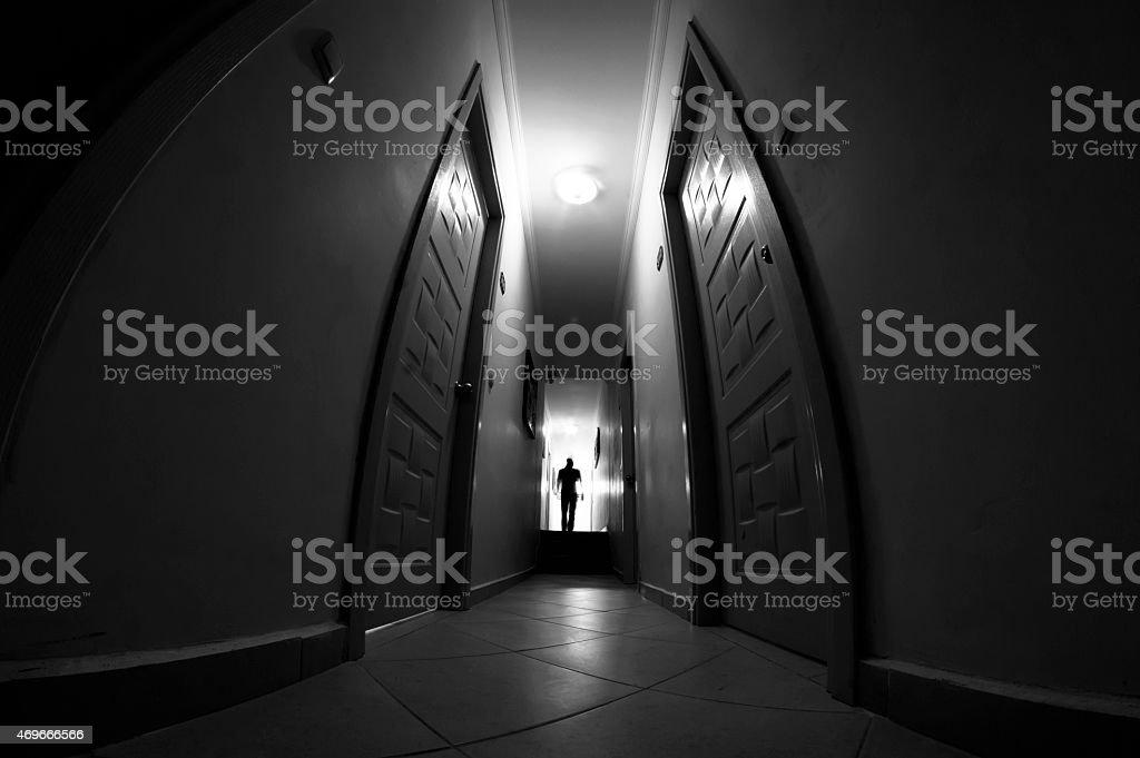 Silhouette in corridor stock photo