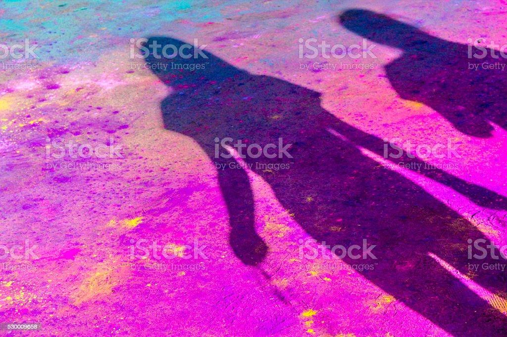 Silhouette in Holi Powder stock photo