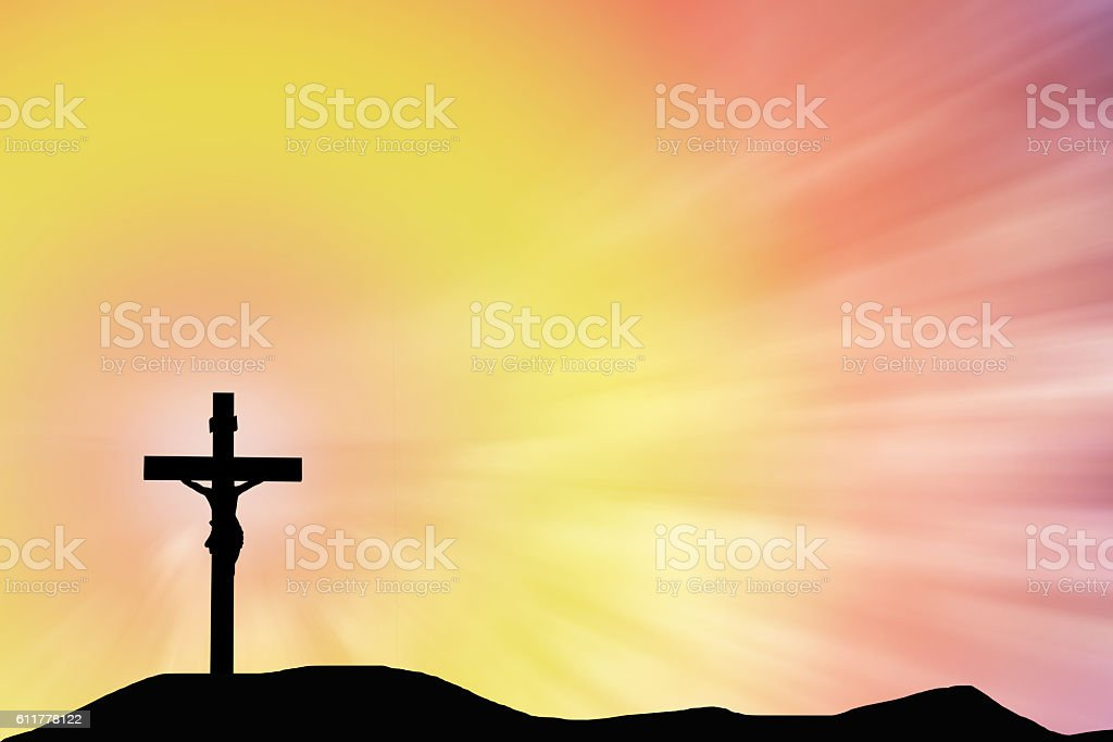 Silhouette Jesus and the cross over sunset on mountain top stock photo