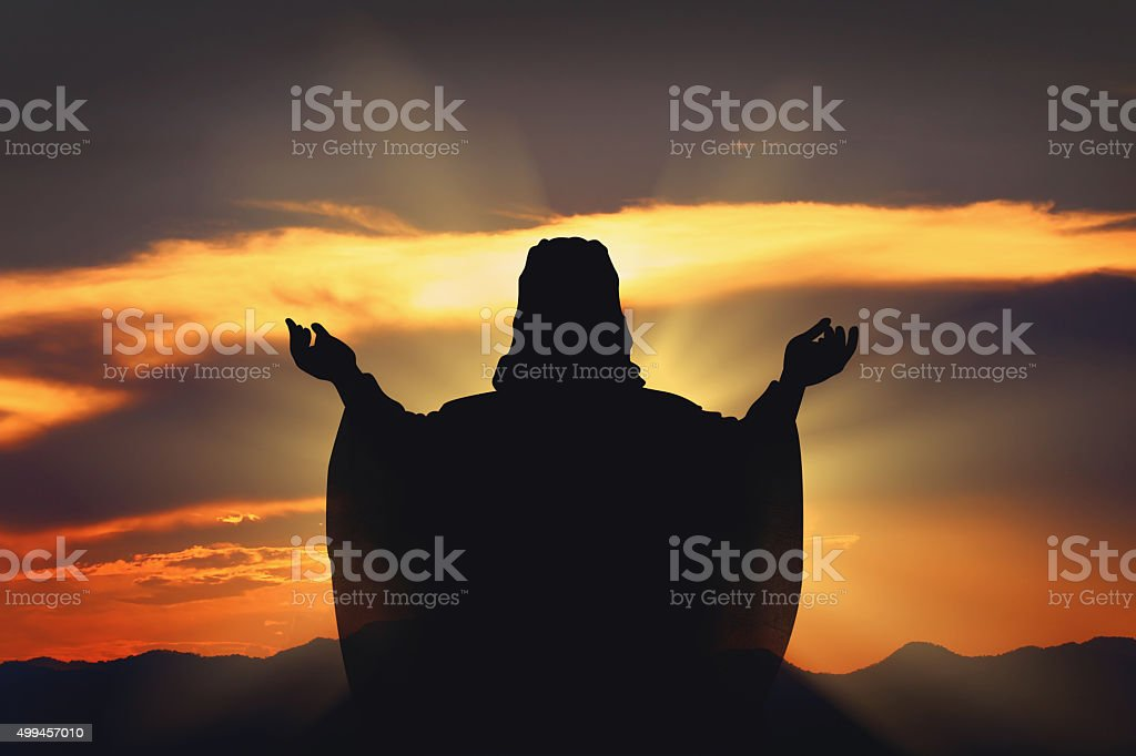 Silhouette Jesus and the sunset stock photo