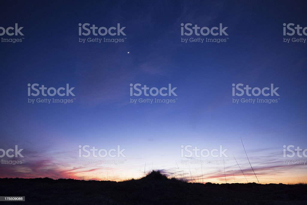 Silhouette landscape shot of beach at sunset royalty-free stock photo