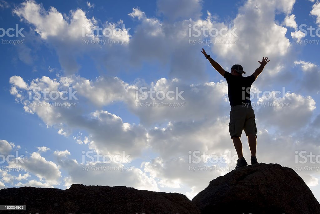 silhouette man arms raised into sunset sky landscape royalty-free stock photo