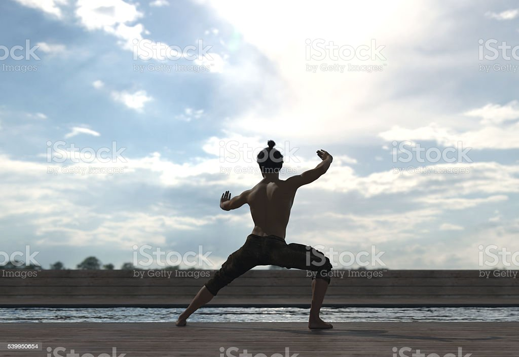 silhouette man doing tai-chi figure outdoor stock photo
