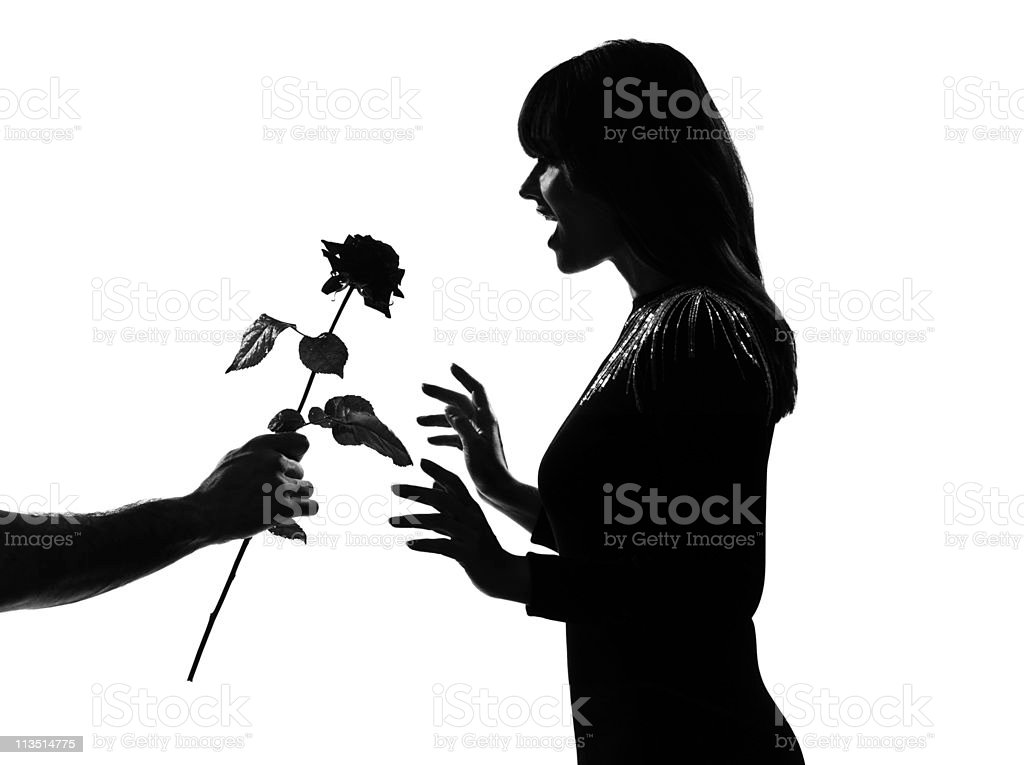 silhouette man hand offering a flower rose royalty-free stock photo