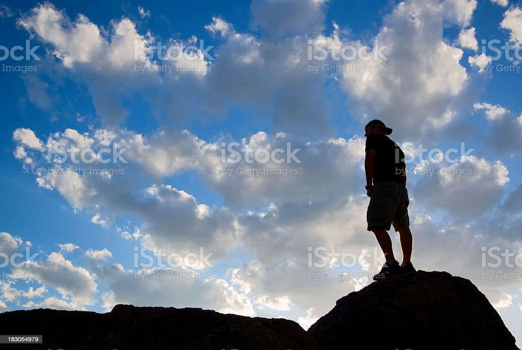 silhouette man looking at sunset sky landscape royalty-free stock photo