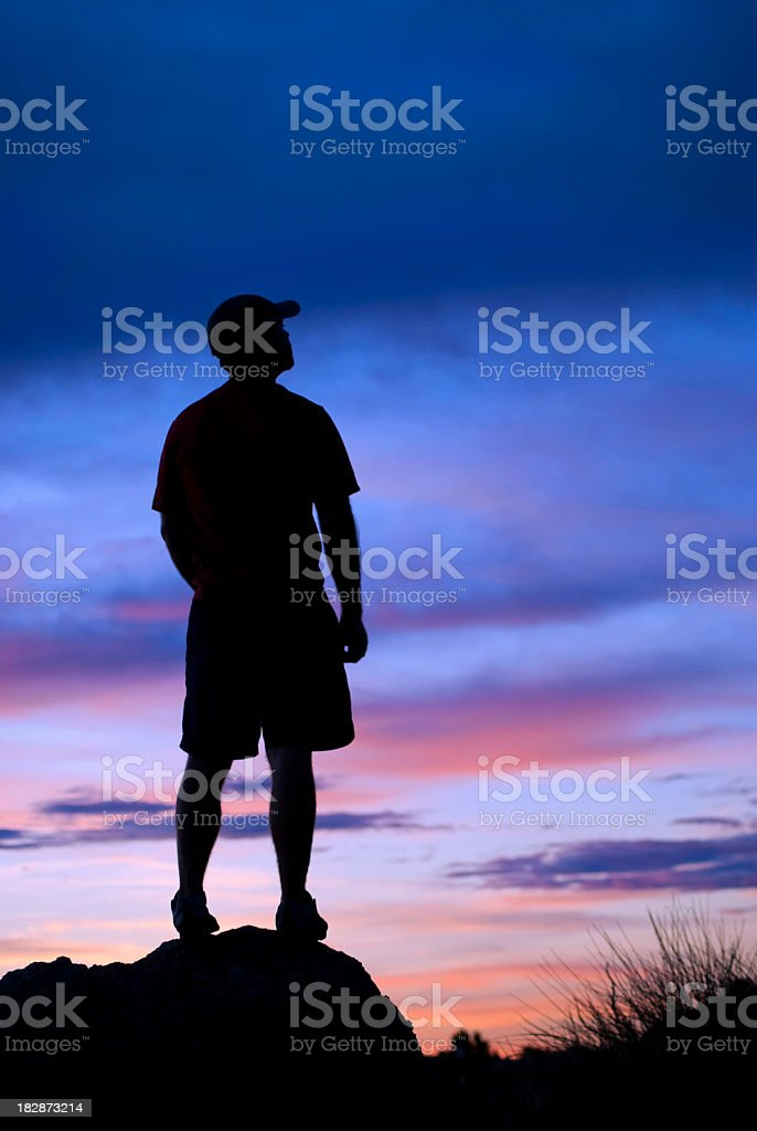 silhouette man looking at sunset sky royalty-free stock photo