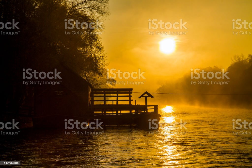 Silhouette mill on Mur River during sunset stock photo