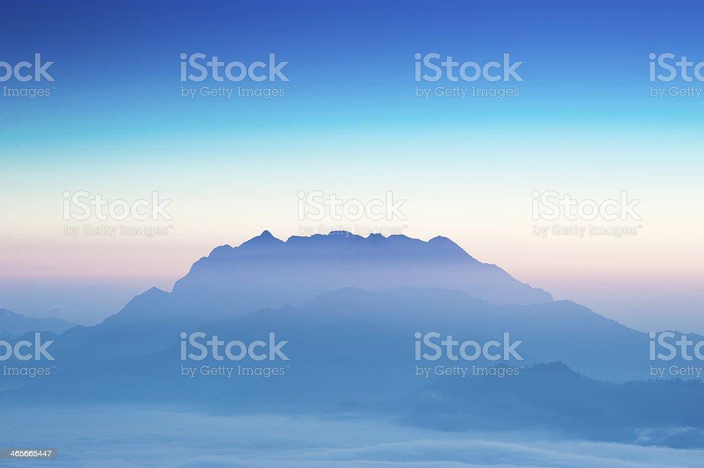 Silhouette Mountain at sunrise stock photo