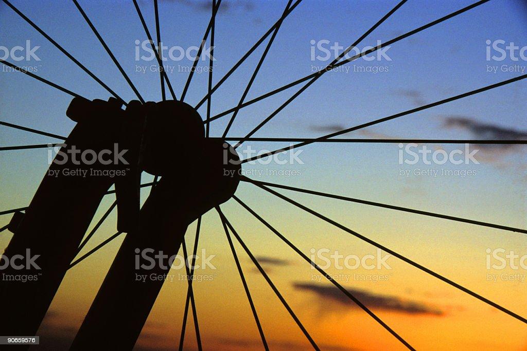 silhouette mountain bike wheel sunset sky stock photo