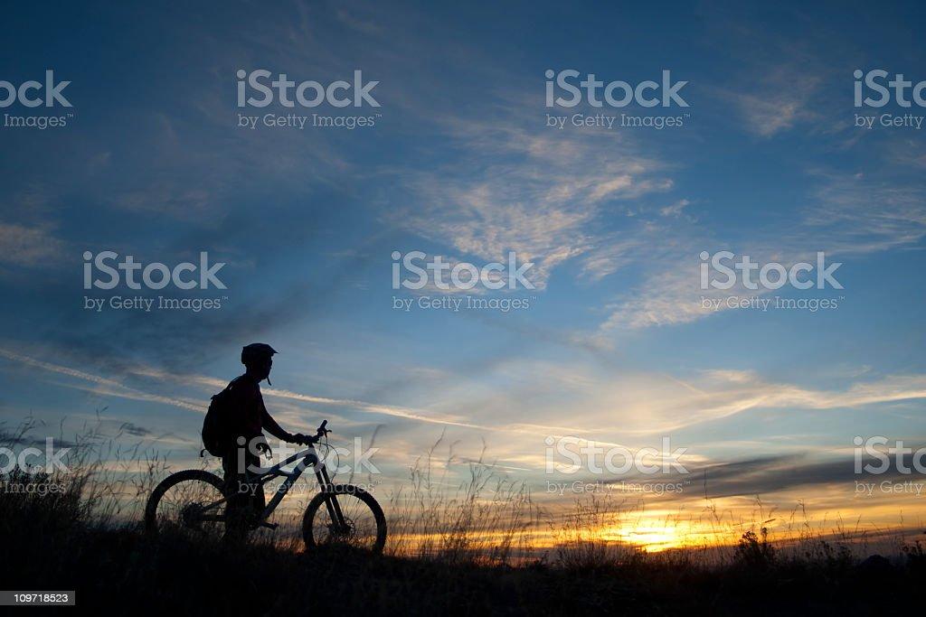 silhouette mountain biker sunset sky landscape royalty-free stock photo