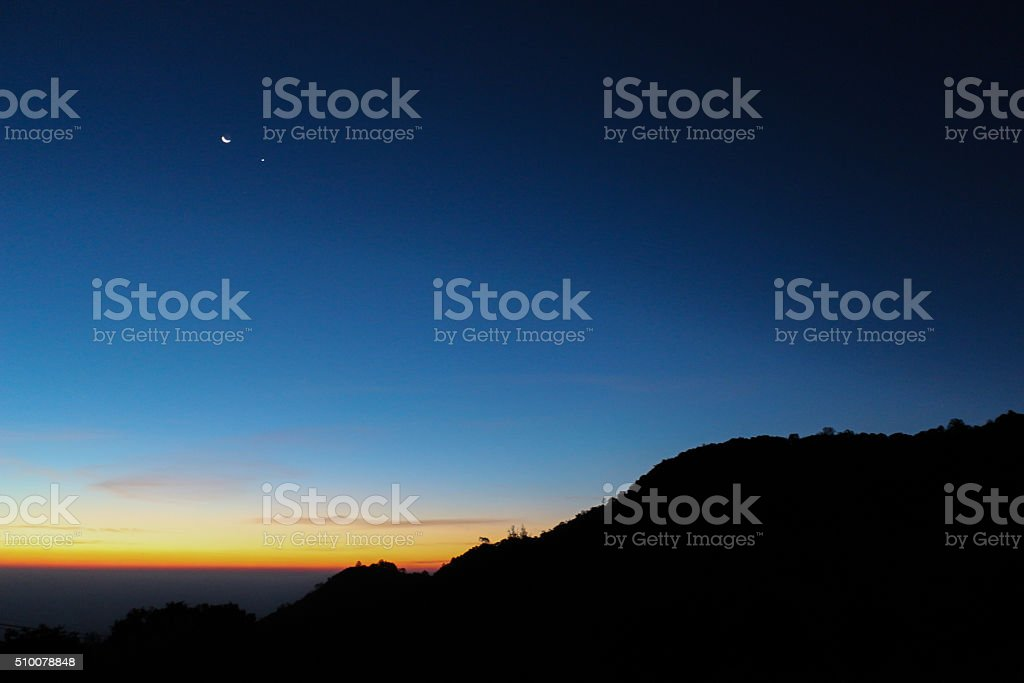 Silhouette mountain with sunrise sky stratosphere background stock photo