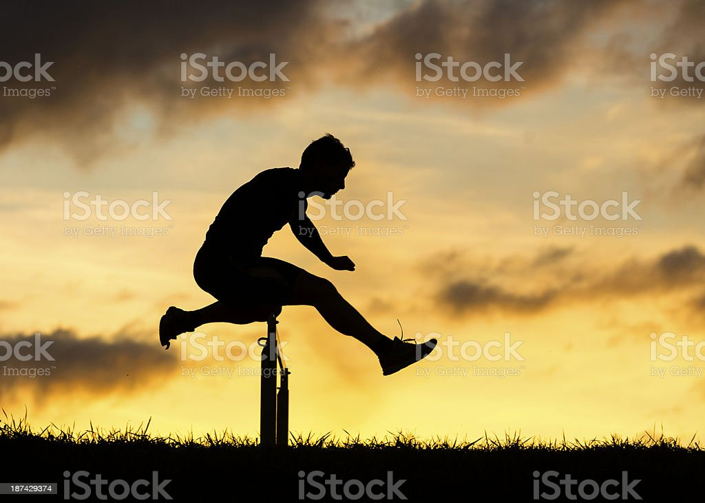 silhouette of a athlete in hurdling stock photo