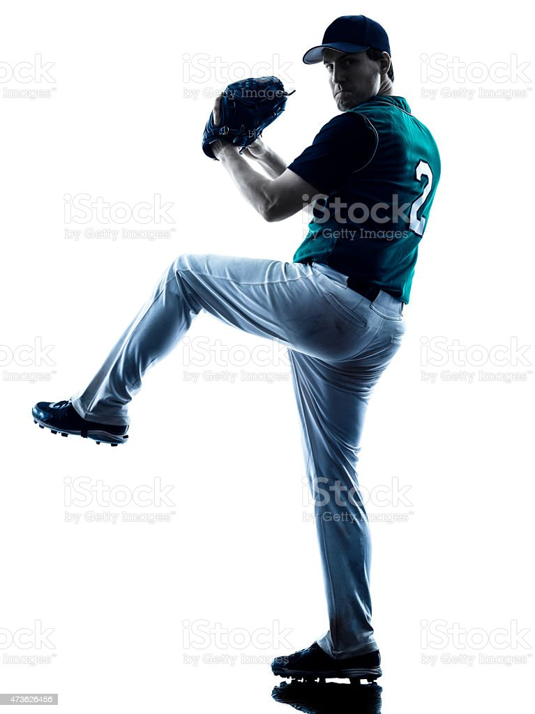 Silhouette of a baseball pitcher winding up to pitch stock photo