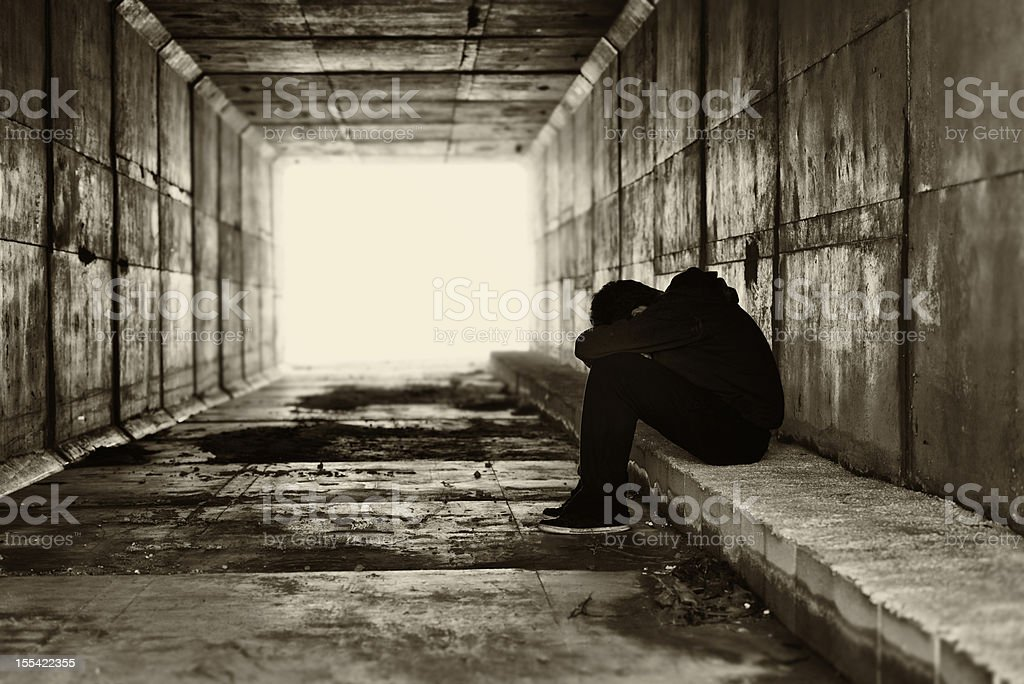 Silhouette of a boy in a tunnel stock photo