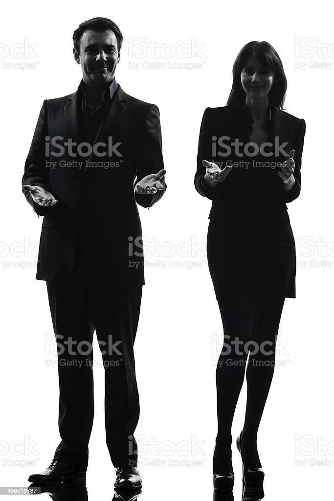 A silhouette of a businessman and woman royalty-free stock photo