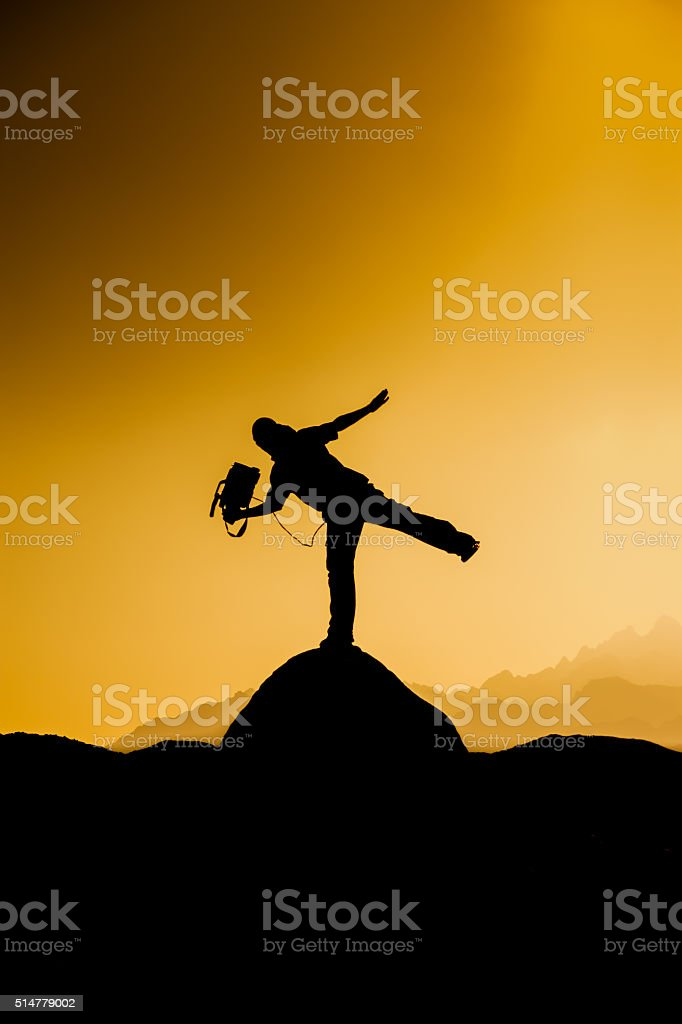 Silhouette of a cameraman at sunset stock photo