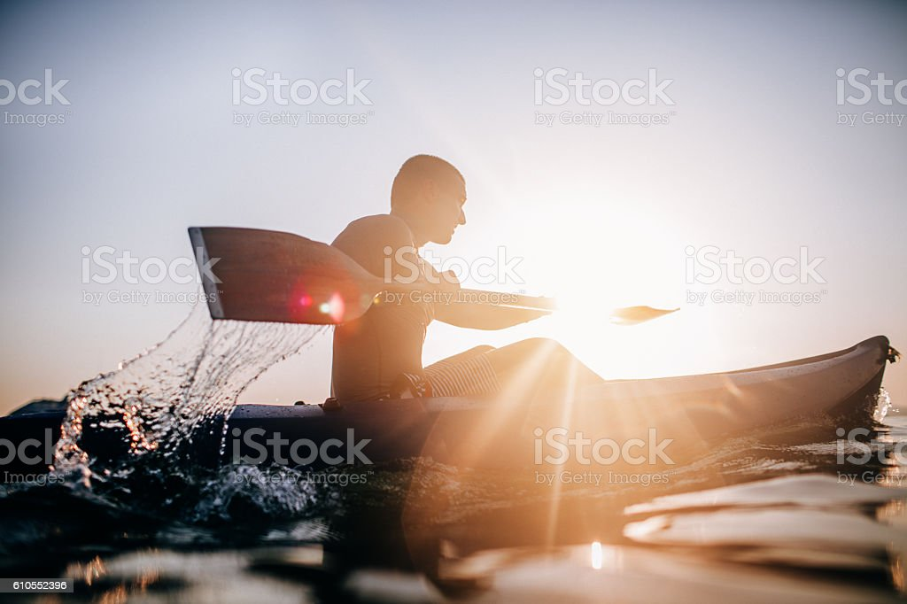 Silhouette of a canoeist stock photo