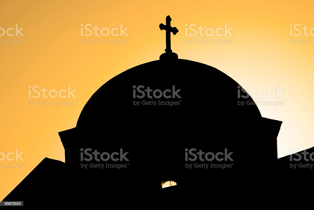 Silhouette of a church in Mykonos, Greece stock photo