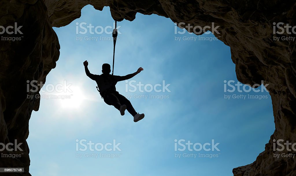 Silhouette of a climber over blue sky stock photo
