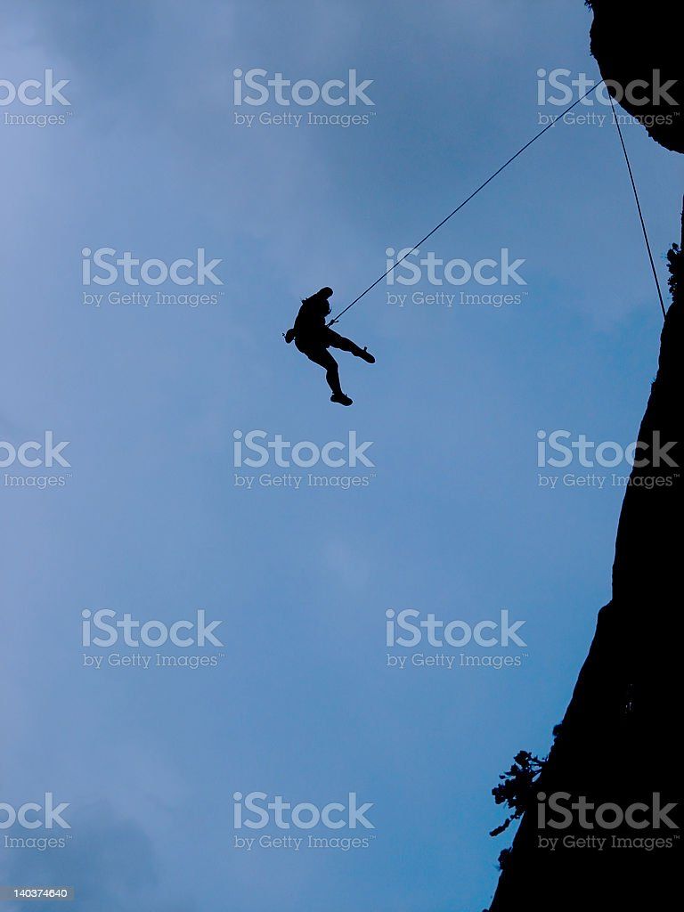 Silhouette of a climber royalty-free stock photo