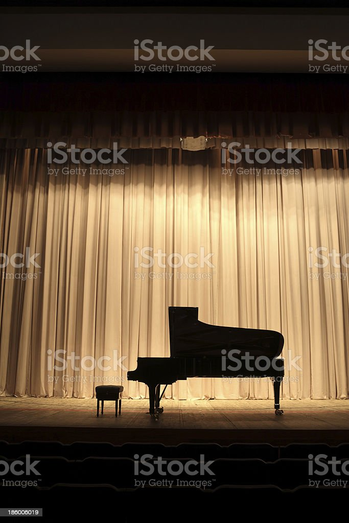 Silhouette of a concert piano on stage stock photo