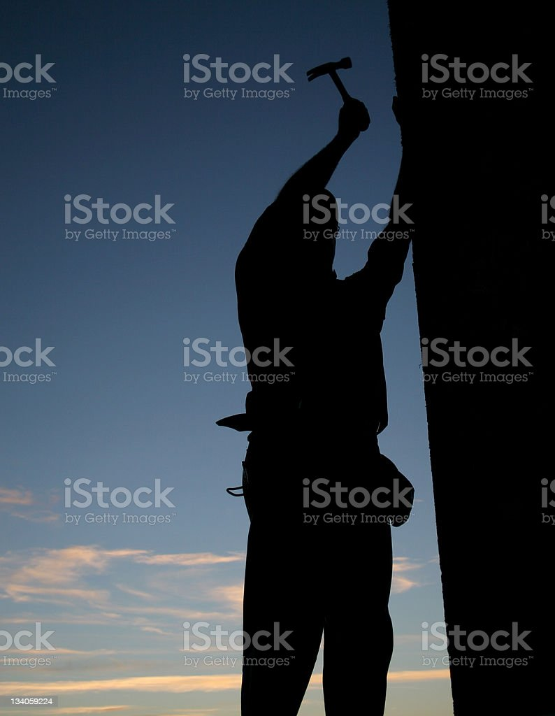 Silhouette of a Construction Worker stock photo