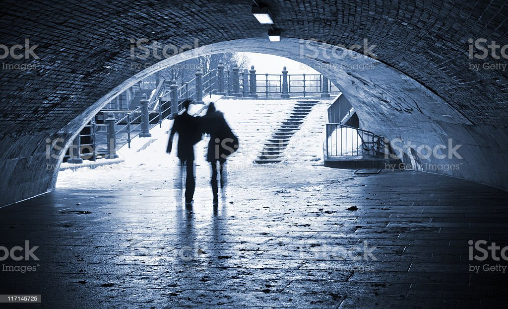 Silhouette of a couple , who goes through the tunnel stock photo