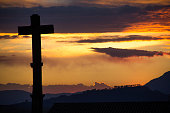 Silhouette of a Cross during a colorful sunset
