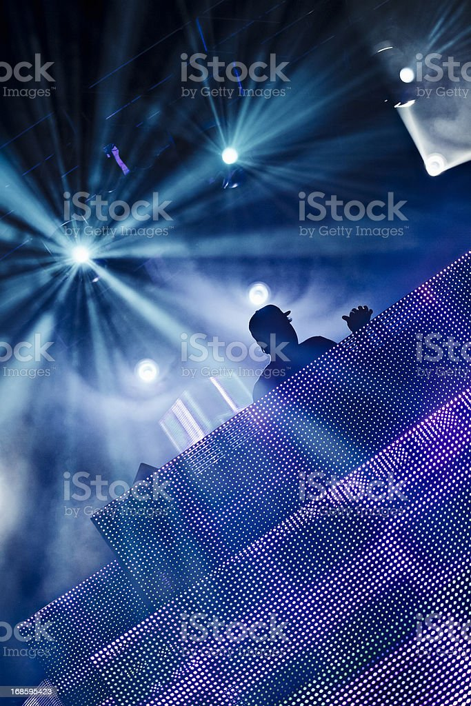 A silhouette of a DJ at a club royalty-free stock photo