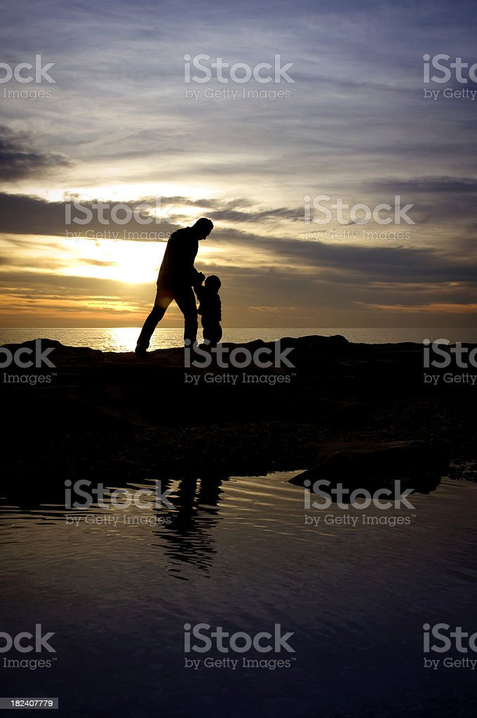 Silhouette of a father and son royalty-free stock photo